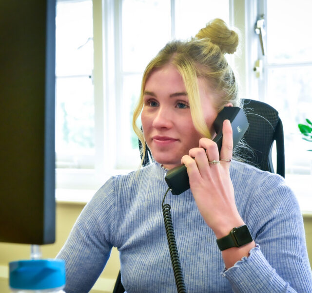 One of our accountants, Amy O'Keeffe, working at her office desk